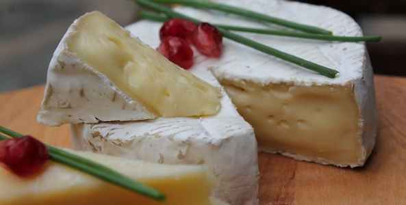Camembert is a delicious French cheese with a white, rind and a soft, moist interior
